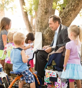 Rollins College President Lewis Duncan joins children at Rollins College Child Development & Student Research Center (CDC).
